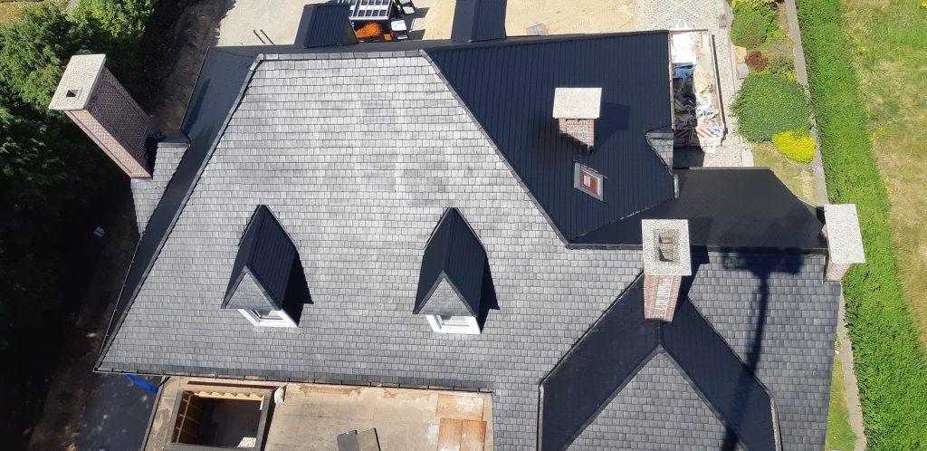 Leien dak laten ontmossen